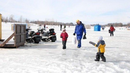 kids and adults on the ice, fishing