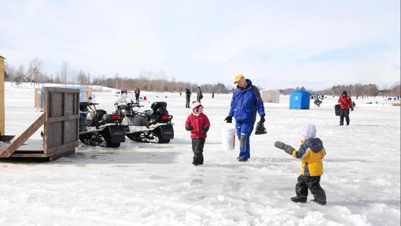 Adults and kids enjoy ice fishing at Binbrook