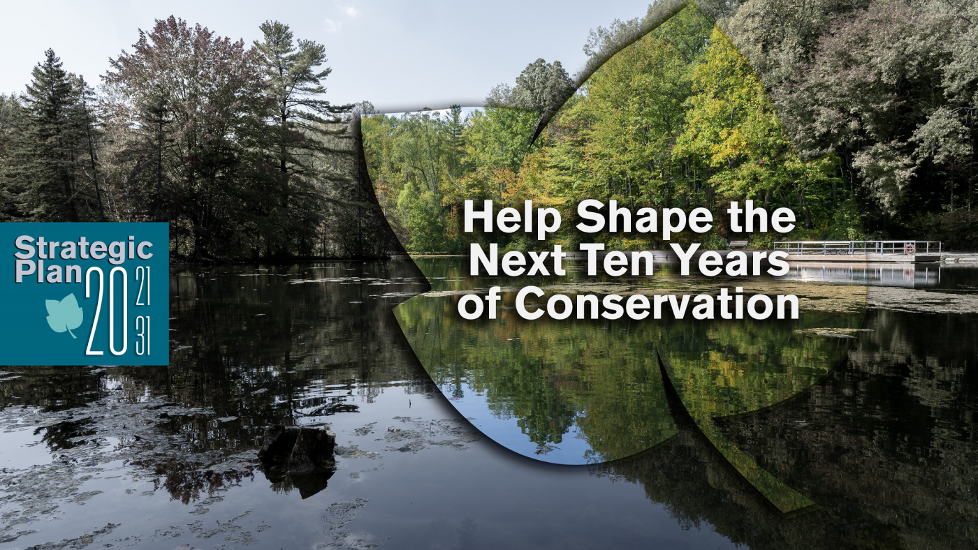 Help shape the next 10 years of conservation text with background photo of St. Johns CA surrounded by green trees, water, and skies