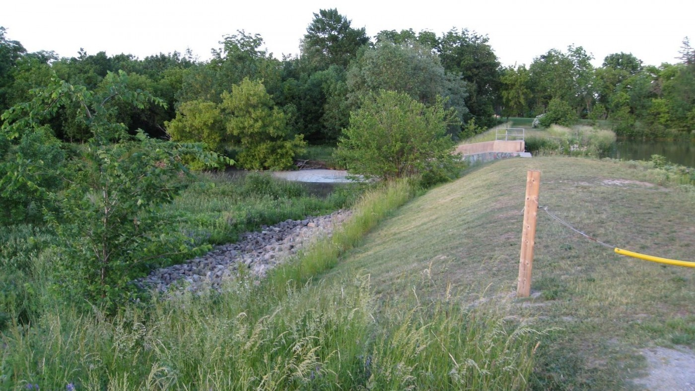 Photo of Virgil Dam- Four Mile Creek- Surrounded by green bushes and water
