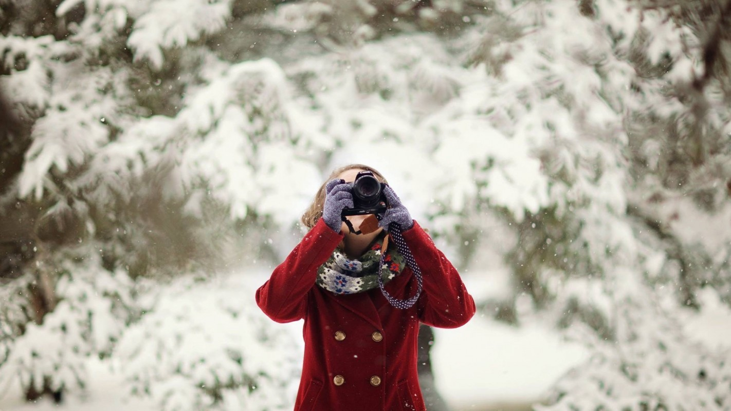 Woman Holding Dslr Camera in front of tree