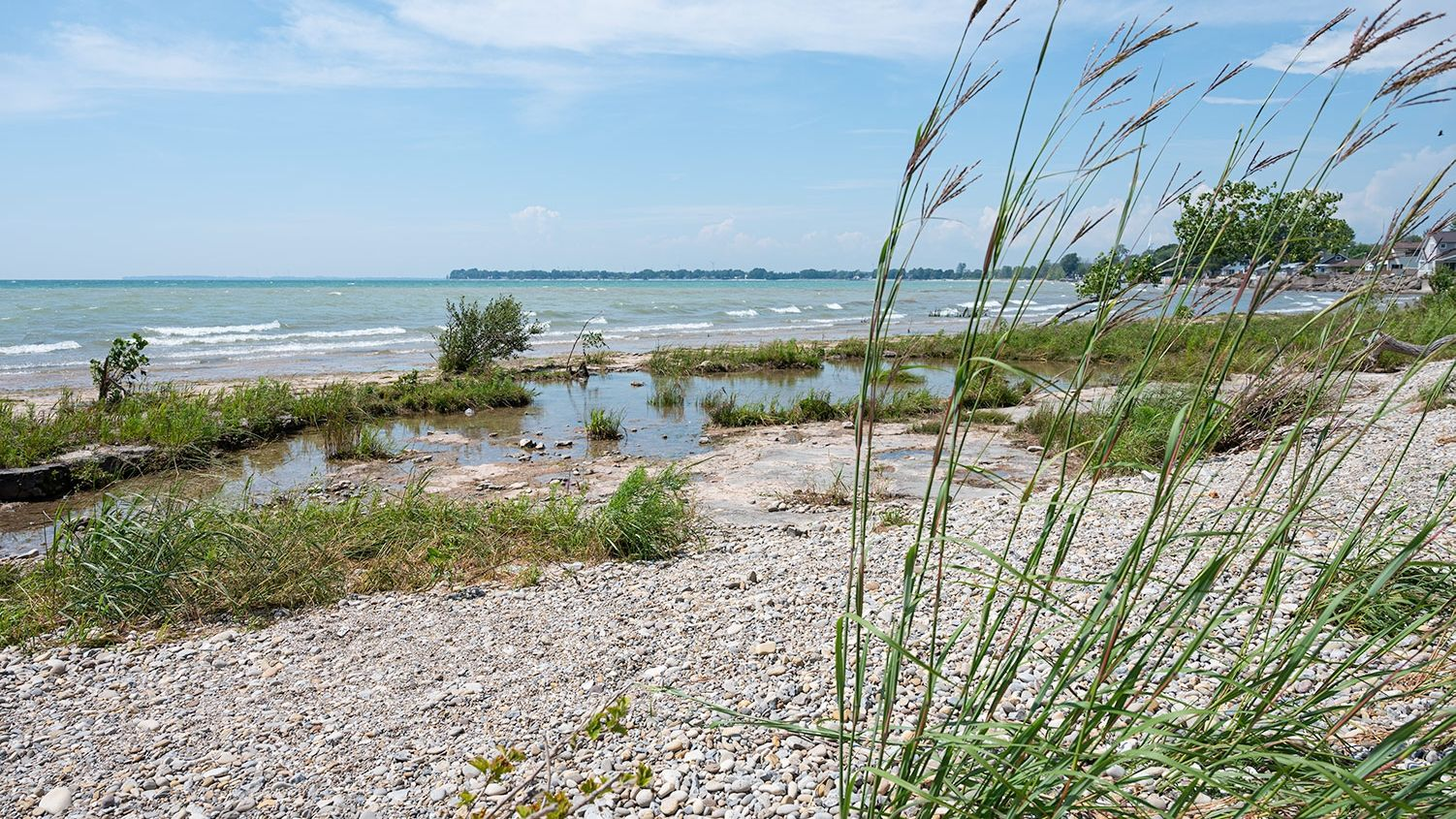 river rock beach by lake and wind